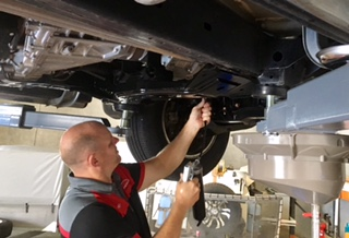 michael from airport automotive service marcoola servicing a car