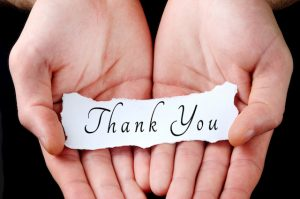 hands holding thank you note reward for car servicing deals and car detailing