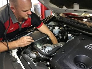 owner of airport automotive service marcoola mechanic performing car servicing